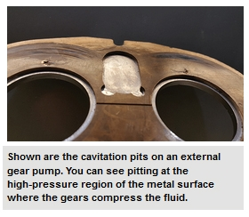 Shown are the cavitation pits on an external gear pump. You can see pitting at the high-pressure region of the metal surface where the gears compress the fluid.
