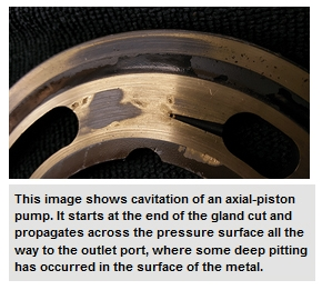This image shows cavitation of an axial-piston pump. It starts at the end of the gland cut and propagates across the pressure surface all the way to the outlet port, where some deep pitting has occurred in the surface of the metal.