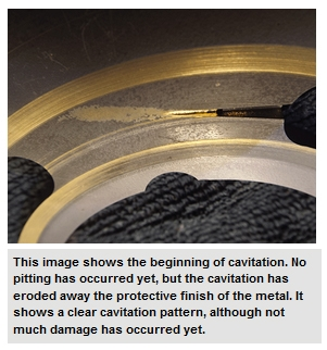 This image shows the beginning of cavitation. No pitting has occurred yet, but the cavitation has eroded away the protective finish of the metal. It shows a clear cavitation pattern, although not much damage has occurred yet.